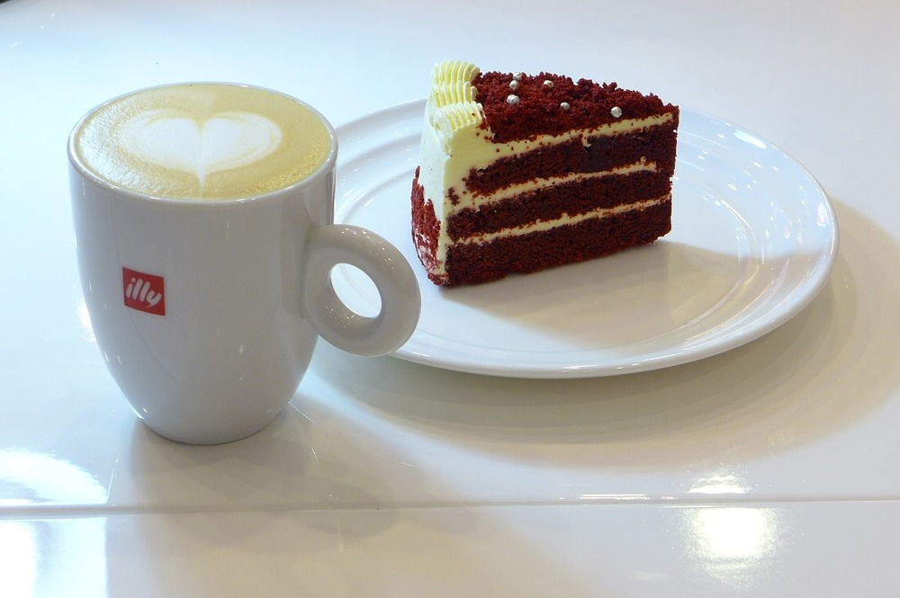 A cup of coffee and a piece of cake